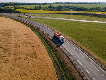 Gasoline truck Oil trailer on highway driving along the road. Standard-Bild