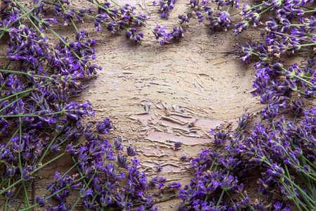 Lavender flower on grunge wooden table. Summer flower background.