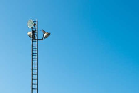 Street light pole in blue sky background.
