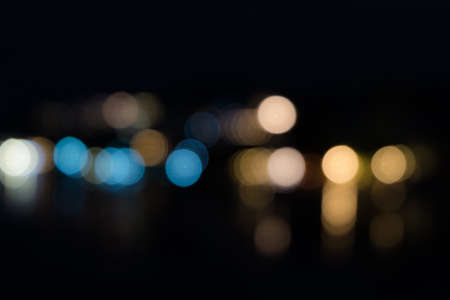 gold textured background: Abstract bokeh from light reflecting over sea at night.