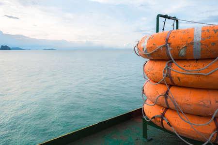 salvavidas: Lifeboat on ferry deck wiht blue sky background.