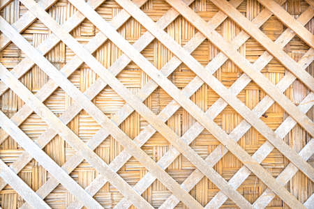 Wood weaving texture background. Wooden are cut straight line on wall pattern in traditional handcraft weave Thai style of nature background wicker surface for furniture and wall decoration.
