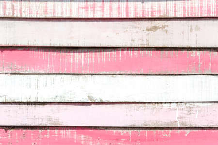 Old white and pink painted vintage wooden texture and background. Grunge wood wall background in pastel sweet color.