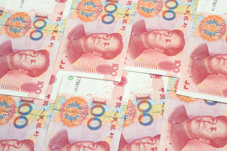 Stack of one hundred Chinese yuan bills as money background. Currency of China.