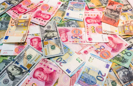 World's major currencies American dollar, Euro money, Australian dollar and Chinese yuan as money background. Stock Photo