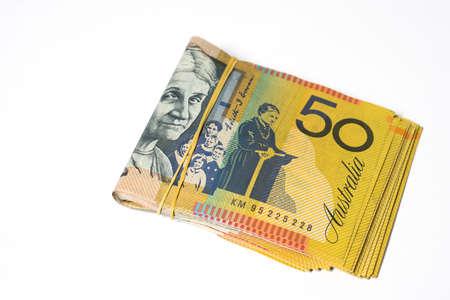 Australian money, Stack of fifty Australian dollar bills on white background.