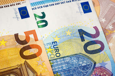 Closeup of 20 and 50 euro banknotes  as money background. Euro currency is the second largest reserve and traded in the world for exchange generally accepted as payment. Finance concept. 版權商用圖片