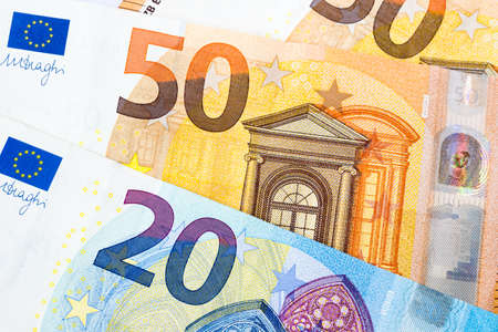 Closeup of twenty and fifty euro banknotes as money bills background. Euro currency is the second largest reserve and traded in the world for exchange generally accepted as payment. Finance concept.
