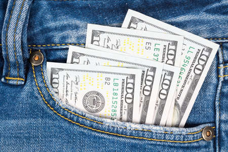 Close up money in pocket of blue jean. One hundred dollar bills in back of jean pocket. Stockfoto