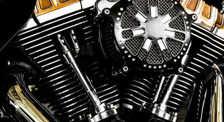 Close-up motorcycle engine, shiny chrome engine block.