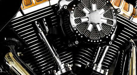 Close-up motorcycle engine, shiny chrome engine block.