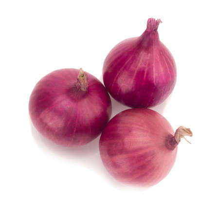 Red sliced onion isolated on white background.