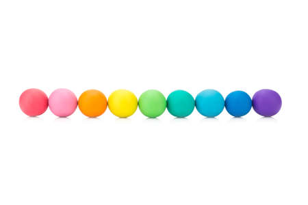 plasticine clay colorful ball rainbow on white background closeup.