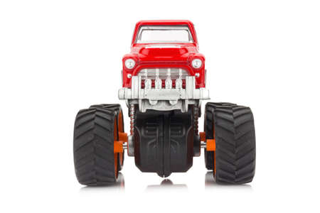 Big truck toy with big wheels bigfoot monster truck isolated big truck toy color red isolated on white background photo publicscrutiny Images