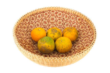 tangerine in wicker baskets isolated on white background.