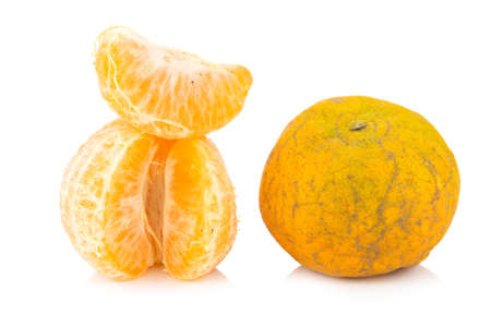 uneatable: orange. rotten. dirty. ripe. peel. isolated on white background. Stock Photo