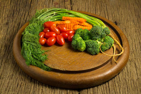 dill. baby tomatoes. carrot. broccoli. on old chopping borad wooden. on old wooden kitchen. Stok Fotoğraf
