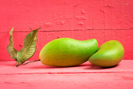 mango green on wood color pink. Stock Photo