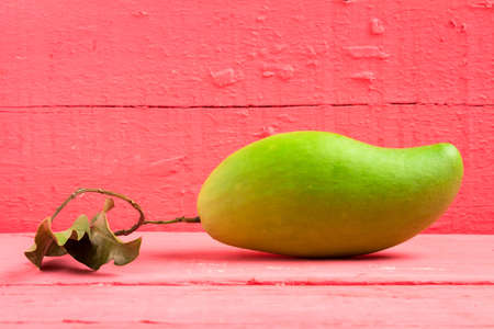 mango green on wood color pink. Stok Fotoğraf