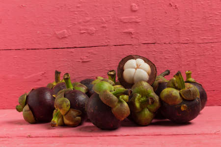 mangosteen on wood pink background.