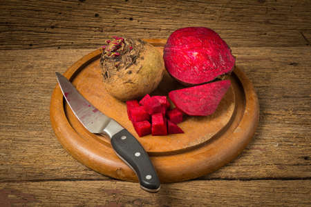 beetroot with knife on wooden.