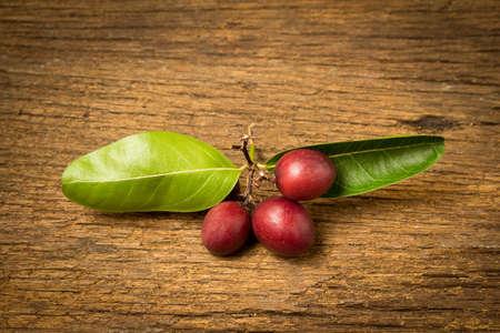 Karonda Fruit on old wood.