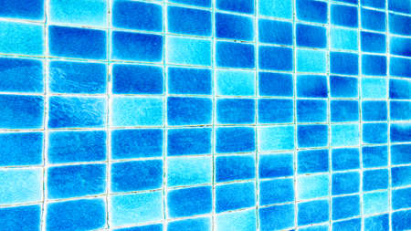 ripple effect: pool with blue ceramic tiles and water ripple effect