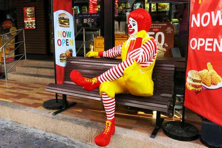 BANGKOK - JANUARY 02: Ronald McDonald character sitting on bench at McDonald Restaurant on 02 January 2016 in Bangkok, Thailand. McDonald's Corporation is the world's largest burger fastfood restaurants.