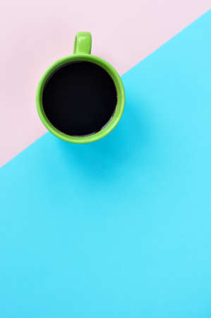 Americano in cups on the pink background.
