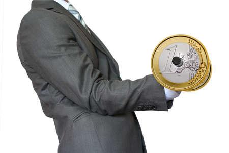 Businessman lifting dumbbell gold Euro photo