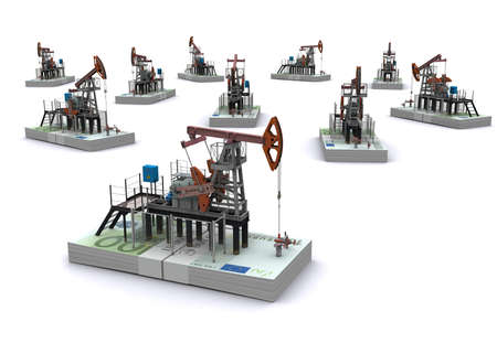 oilwell: Oil pump-jacks stands on a packs of euro Stock Photo