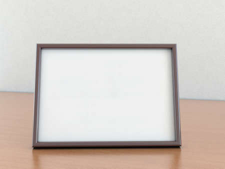 An Empty Photo Frame Stands On A Wooden Table Stock Photo, Picture ...