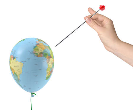 The hand with the needle aimed at the balloon with the texture of the planet earth  Isolated on white background Stock Photo