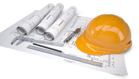 Helmet and tools for construction drawings  Isolated on white background photo
