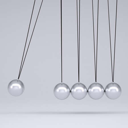 Close up of Newton s cradle  Isolated render on gray background photo