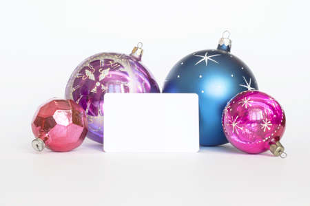 Arrangement of Christmas tree decorations and white card  white background photo