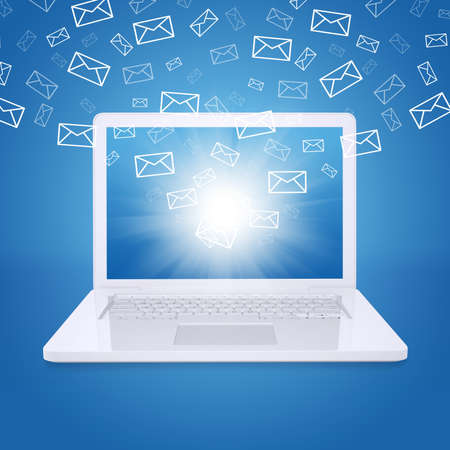 Emails fly out of laptop screen  The concept of e-mailing Stock Photo