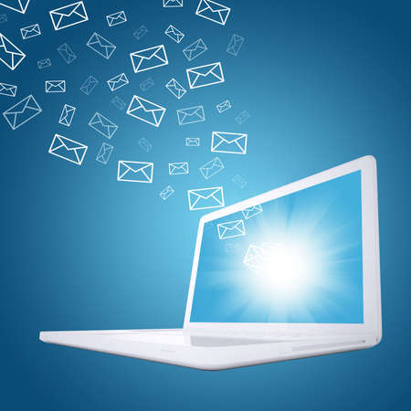 Emails fly out of laptop screen  The concept of e-mailing Banque d'images