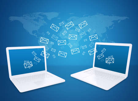 Two laptops exchange letters  The concept of e-mailing Stock Photo