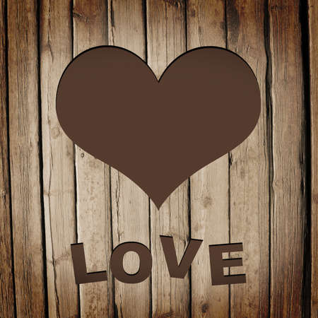 Heart carved on a wooden surface  The concept of Valentine s Day photo