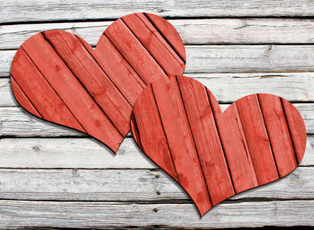 hearty: Two heart carved on a wooden surface  The concept of Valentine s Day Stock Photo