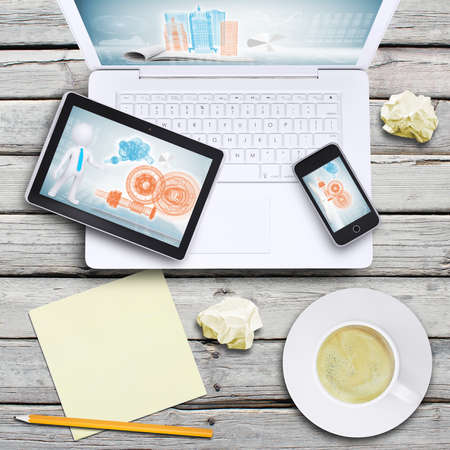 Laptop, tablet pc, smartphone and coffee cup on old wooden boards  Computer technology concept 写真素材