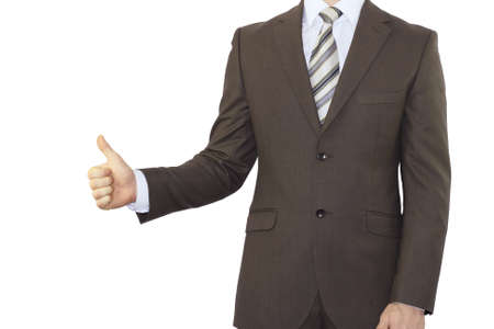 Businessman in a suit holding his thumb up  Isolated on white  photo