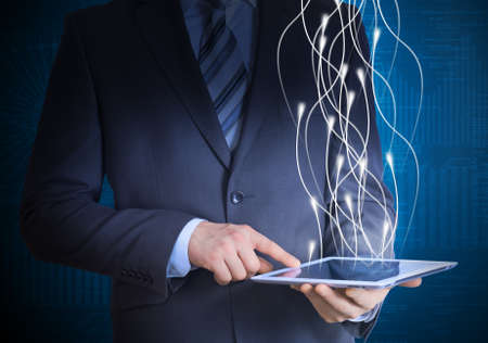 Businessman in a suit holding a tablet computer photo