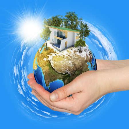 Руки держат землю Фото со стока - 26310966
