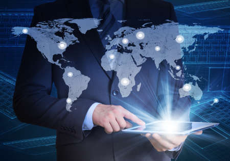 Man in suit, world map and contacts photo