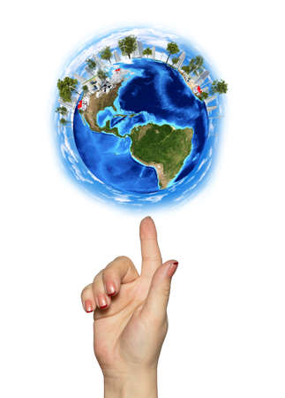 Hand goes to the planet Earth Isolated on white background photo