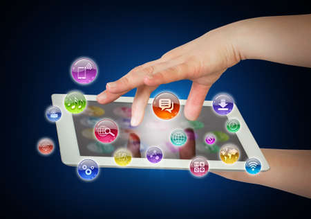 Hands holding tablet pc and application icons  The concept of software photo
