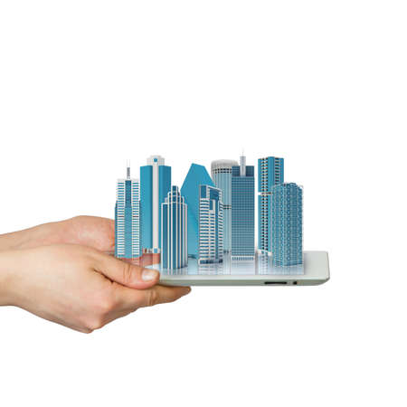 Hands holding a tablet computer  In screen tablet city of skyscrapers photo
