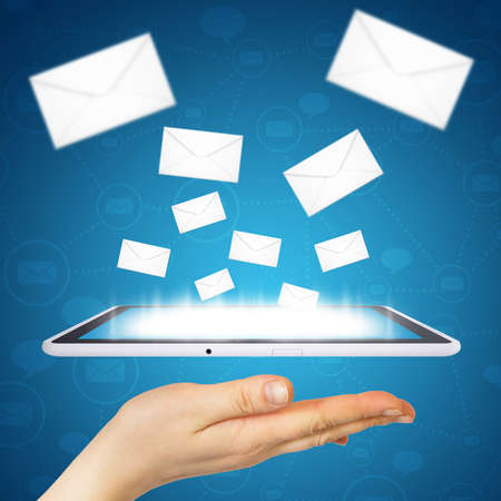 Hand holding a tablet pc  Letters are emitted from the screen of tablet  Concept electronic mailing